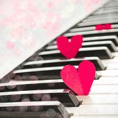 Paper hearts on piano, love music concept
