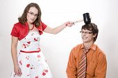 foto of adversity humor  - Young pretty wife strikes her husband in studio - JPG