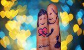Lovers fingers on bokeh background