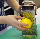 A person grating a lemon