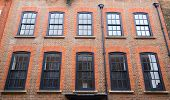 stock photo of edwardian  - the exterior of a london property with beautiful windows - JPG