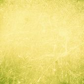 Grunge Abstract Yellow  Textured  Background With Spotlight And Scratches. Yellow Grunge Wall Closeu