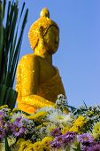 Flower Scene And Buddha As Backdrop