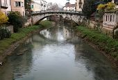 stock photo of vicenza  - bridge with the River in the city of Vicenza in Italy - JPG