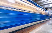Blue Subway Train In Motion At The Underground Station