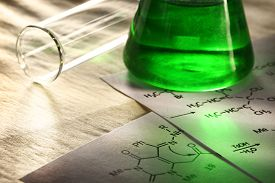 foto of chemical reaction  - Green chemistry with reaction formula in closeup - JPG