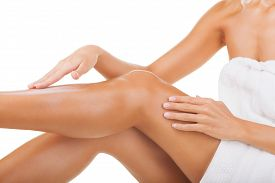 image of body-lotion  - Care for female legs isolated on white background - JPG