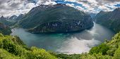 foto of eagle  - Panorama of the whole Geirangerfjord a UNESCO heritage site and the village of Geiranger and some mountains in M - JPG