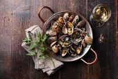 pic of clam  - Shells vongole venus clams with parsley in copper cooking dish on dark wooden background - JPG