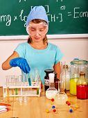 stock photo of chemistry  - Child holding flask in chemistry class - JPG