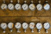 picture of pressure vessel  - Old pressure gauge or damage pressure gauge of oil and gas industry on wooden background - JPG