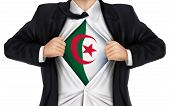 picture of algeria  - businessman showing Algeria flag underneath his shirt over white background - JPG