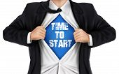 foto of start over  - businessman showing Time to start words underneath his shirt over white background - JPG