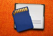 stock photo of memory stick  - Blue compact memory cards for camera on cloth - JPG