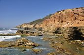 pic of bluff  - Numerous tidepools lie at the base of sculpted seaside bluffs at Point Loma in San Diego - JPG