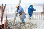 stock photo of millwright  - construction site worker at concrete works at building area  - JPG