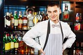 picture of bartender  - Portrait of young barman worker at bartender desk in restaurant bar  - JPG
