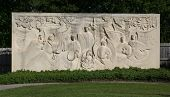 picture of funeral home  - large carved stone of watching over a beautiful cemetary - JPG