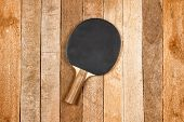stock photo of ping pong  - Ping pong paddle on a vintage wooden background - JPG