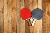 stock photo of ping pong  - Ping pong paddles and ball on vintage background - JPG