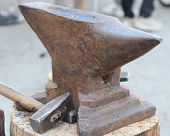stock photo of anvil  - heavy ANVIL and sturdy HAMMER in the blacksmith - JPG