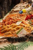 stock photo of stall  - Fishmonger stall in an indoor market with fresh seafood and fish - JPG