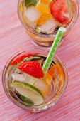 stock photo of sangria  - Refreshing white sangria (punch) with fruits picnic idea