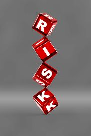 picture of risk  - Balancing dice with letters on them spelling  - JPG