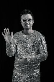 picture of spaceman  - Portrait of spaceman greeting over dark background - JPG