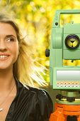 Girl And Total Station