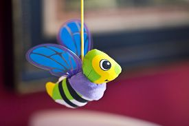 image of jousting  - Little bee hanging above baby bed - JPG