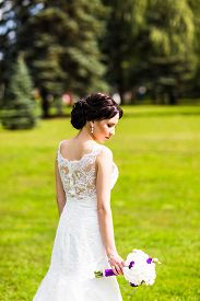 picture of wedding  - Beautiful bride in wedding dress and bridal bouquet - JPG