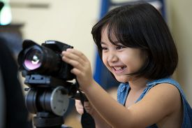 stock photo of little girls photo-models  - Little Asian girl photographerlooking and take the photo by your camera - JPG