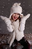 A cute young girl playing in the snow