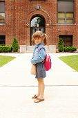 A cute young girl going to school