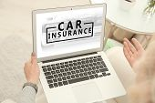 Woman using laptop at home. Car insurance concept poster