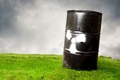 Contaminating Drum Barrel On Grass To Represent Pollution