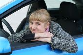 Blonde Girl In A Blue Car