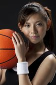 pic of asian woman  - Young Asian woman ready to play basketball - JPG