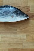 Sea bass on a chopping board
