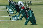 stock photo of golf bag  - photographed golf bags all lined up at a golf school in florida - JPG