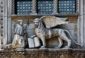 The Venetian Lion And Doge On A Cathedral Building On San Marco Square. Venice. Italy.