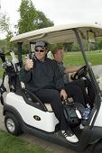 TARZANA, CA - APRIL 18:Adam Baldwin heads out to the golf course at the 8th annual
