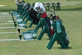 picture of golf bag  - photographed golf bags all lined up at a golf school in florida - JPG