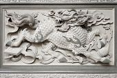 stock photo of chinese unicorn  - Stone Carving of Qilin on Chinese Temple Wall in Chinatown - JPG