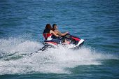 Couple Riding Tandem On A Jetski