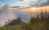 Phu Nom At Phu Langka National Park With Sunset And Fog On Sky. Phu Nom At Phu Langka National Park  poster