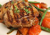 Chargrilled tuna fish steak with stir-fried vegetables.