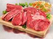 stock photo of charcuterie  - Raw beef shank steak on cutting board and steel table - JPG