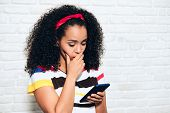 Sad Desperate Girl Woman Receiving Bad News On Cell Phone poster